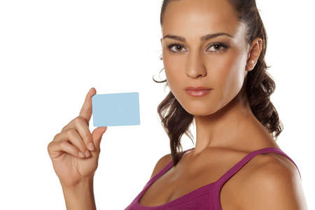 serious beautiful girl showing her credit card photo