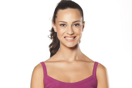 falsely: beautiful girl smiles falsely