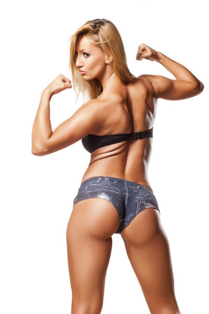 Rear view of pretty and muscular girl with blond hair photo