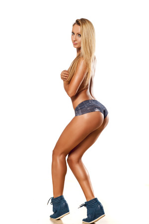 Side view of pretty and muscular girl with blond hair photo