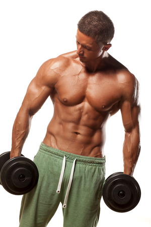 muscular super-high level  handsome man holding weights and posing on a white background photo