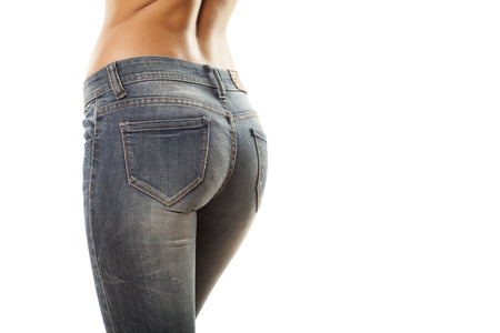 pretty women  s ass in tight jeans on white background photo