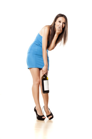 alcohol bottles: cute drunk girl with a bottle in her hand on a white background
