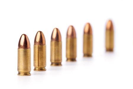 Row of 9mm bullets on white backgronud  photo