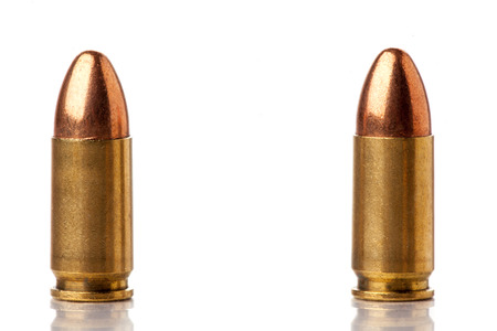 two 9mm bullets for a gun isolated on a white background photo
