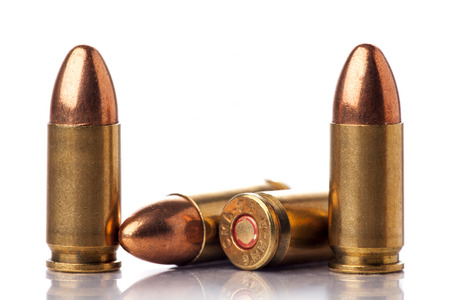 luger: A group of 9mm bullets for a a gun isolated on a white background