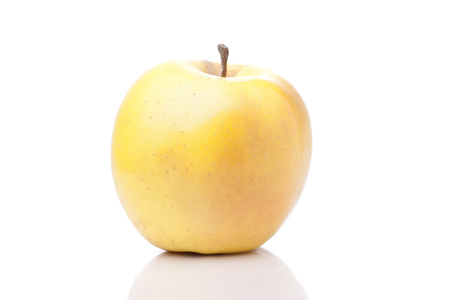 yellow apple: Big yellow apple on a white background