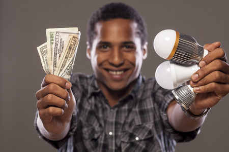 cree: smiling man showing money saved by using LED bulbs