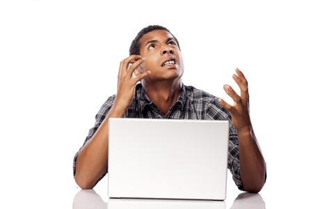 helpless: dark-skinned young man making desperate and helpless gesture Stock Photo