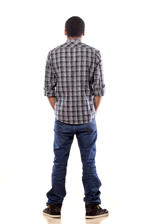 hands on pocket: rear view of young black man with his hands in his pockets