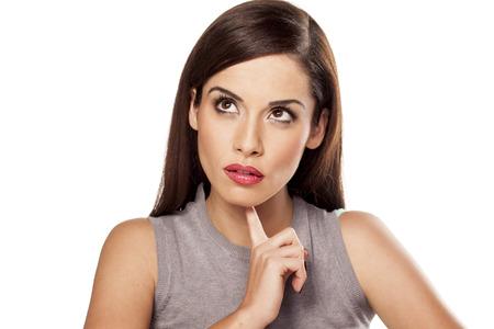 chin: pensive woman touching her chin Stock Photo
