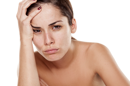 dissapointed: sad and disappointed young woman on a white background