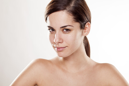 without people: Positive young beautiful woman without make up posing on white background