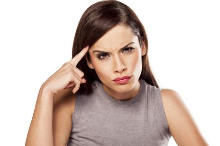 그녀의 이마를 만져 화가 잠겨있는 여자 스톡 콘텐츠