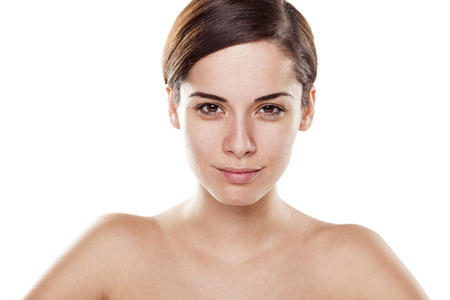 young woman without make-up on white background Stock Photo
