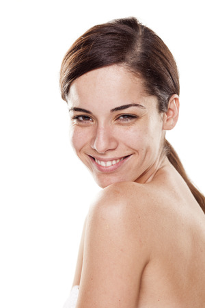happy young beautiful woman without make up posing on white background