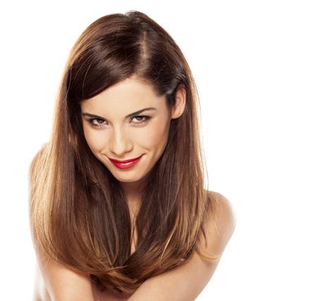 nude young: красивая и великолепная брюнетка с прямыми волосами на белом фоне Фото со стока