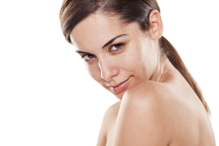 Positive young beautiful woman without make up posing on white background
