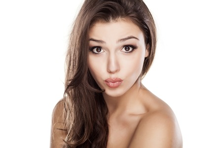 kissing lips: Young beautiful woman with kissing gesture