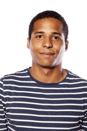 portrait of a smiling dark-skinned young man on white background Stock Photo