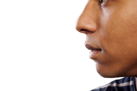 nose close up: close up shot of nose and a mouth of a dark-skinned young man Stock Photo