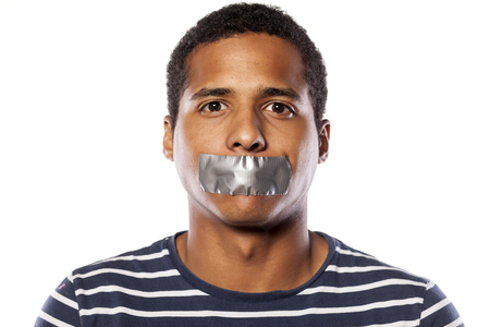 dark-skinned young man with adhesive tape over his mouth