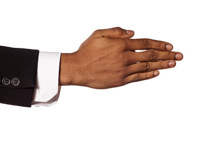 collected: dark skinned hand in a suit with fingers collected