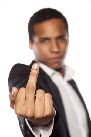 middle finger: angry african businessman showing middle finger