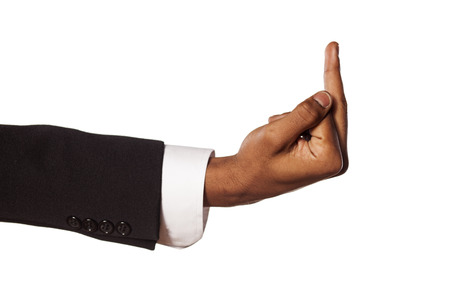 middle finger: dark skinned hand in a suit showing middle finger