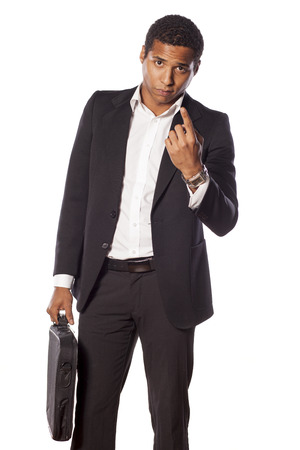 beckon: serious dark-skinned businessman with a beckoning gesture
