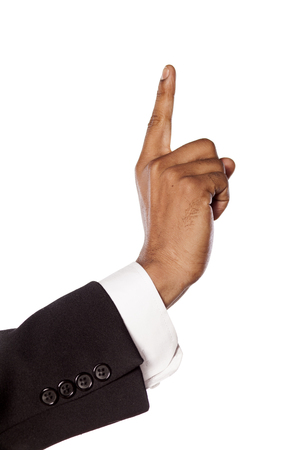 dark skinned: dark skinned hand in a suit showing direction