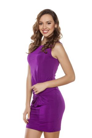 pretty dress: beautiful young woman posing in a violet tight short dress