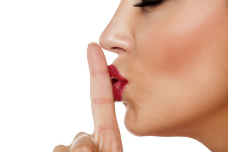 finger on her lips. gesture for silence Stock Photo