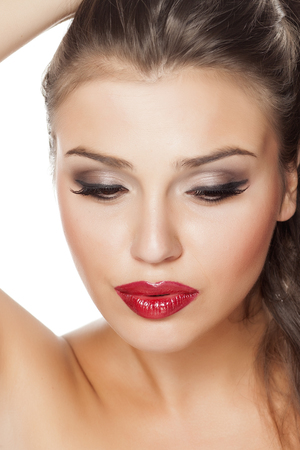 fake eyelashes: beautifully made-up female face Stock Photo