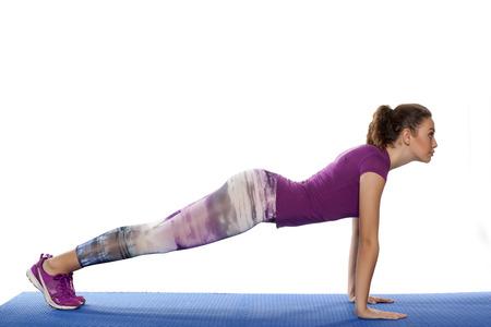 pretty girl doing basic yoga exercises