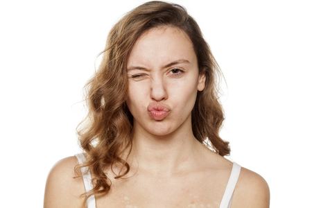 without: young woman without make-up with pursed lips