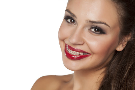 smiling beautiful young woman with braces Stock Photo