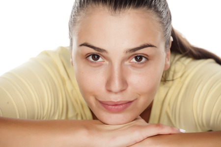 without people: young beautiful woman without makeup on a white background Stock Photo