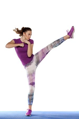 leggings: pretty girl exercising foot kick