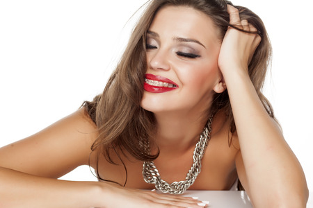 makeup eyes: a young beautiful woman posing with a big necklace
