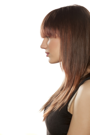 bangs: profile of a young woman with bangs Stock Photo