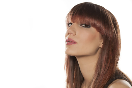 bangs: profile of a young woman with bangs posing on a white background Stock Photo