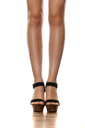 50e9fa96731268  62282841 - feminine legs in high heels sandals with platforms