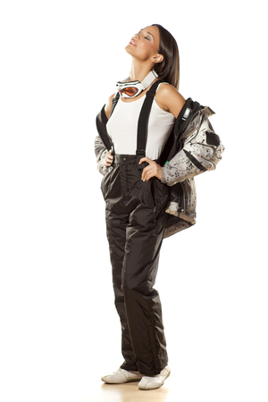 black ski pants: beautiful attractive girl posing in ski pants and jacket Stock Photo
