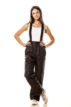 black ski pants: attractive girl posing in ski pants on white background