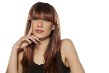 bangs: young woman with bangs posing on a white background