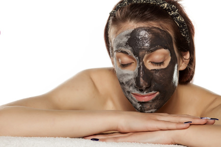 mud woman: young woman with mud mask on her face