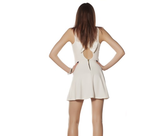 beautiful bangs: Back view of a young woman in white summer dress Stock Photo