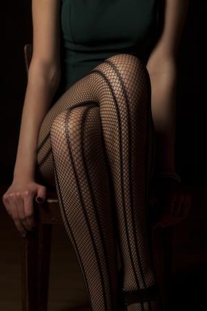legs stockings: feminine crossed legs in fishnet stockings