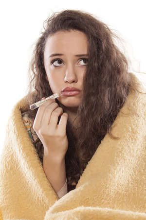 body temperature: sick young girl measuring body temperature with thermometer Stock Photo